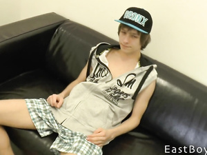 Teen gay kid is sitting on couch and being hotly fondled