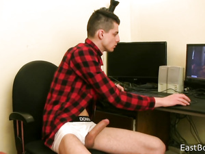 Handsome twink watches gay porn videos and jerks off dick