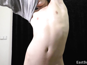 Young gay dude is hotly undressing and masturbating to the camera
